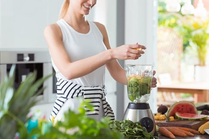 Woman Using Kitchen Blender